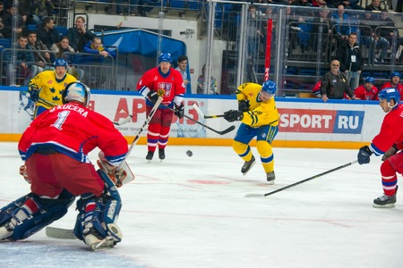 honored: MOSCOW - JANUARY 29, 2016: Swedish team forward Magnus Roupe (19) on hockey game Sweden vs Czech Republic on World Legends hockey league on January 29, 2015, in Moscow, Russia.