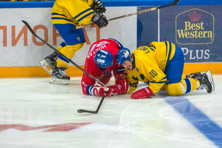 willy: MOSCOW - JANUARY 29, 2016:  Willy Lindstrom (20) � Martin Hostak (20) on hockey game Sweden vs Czech Republic on World Legends hockey league on January 29, 2015, in Moscow, Russia.