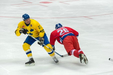 legends: MOSCOW - JANUARY 29, 2016:  Jiri Krasny (26) è Tomas Eriksson (27) on hockey game Sweden vs Czech Republic on World Legends hockey league on January 29, 2015, in Moscow, Russia. Editorial