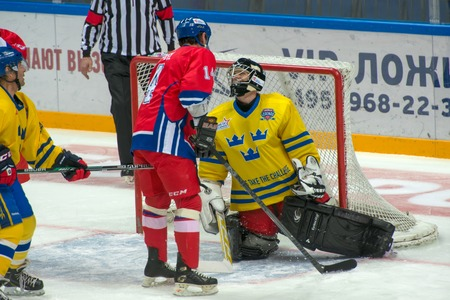 legends: Goalkeeper Rolf Wanhainen 30 and forward David Pospisil 14 on hockey game Sweden vs Czech Republic on World Legends hockey league on January 29, 2015, in Moscow, Russia. Editorial