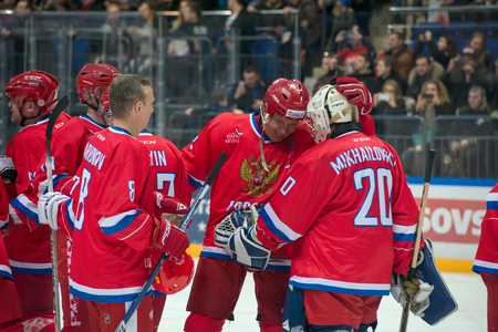 scored: MOSCOW - JANUARY 29, 2016: The players  Russian National Team are happy scored a goal during hockey game Russia vs Finland on World Legends hockey league, in VTB Arena Ice Palace, Moscow, Russia