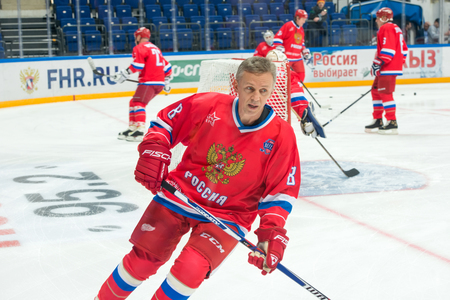 legends: MOSCOW - JANUARY 29, 2016: Forward the Russian National Team, Igor Larionov (8) on hockey game Russia vs Finland on World Legends hockey league, in VTB Arena Ice Palace, Moscow, Russia Editorial