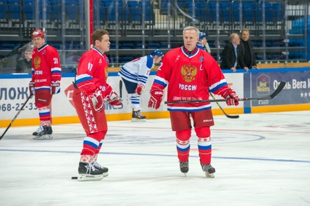 honored: MOSCOW - JANUARY 29, 2016: Captain of the Russian National Team Vyacheslav Fetisov (2) on hockey game Russia vs Finland on World Legends hockey league, in VTB Arena Ice Palace, Moscow, Russia