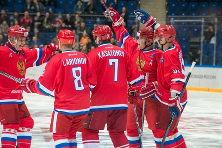 hockey stick: MOSCOW - JANUARY 29, 2016: The players  Russian National Team are happy scored a goal during hockey game Russia vs Finland on World Legends hockey league, in VTB Arena Ice Palace, Moscow, Russia
