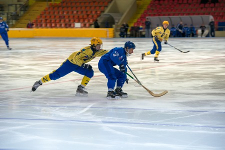 bandy: MOSCOW - FEBRUARY 26, 2016: Dmitry Savelyev 19 in action during the Russian bandy league game Dynamo Moscow vs Zorky Krasnogorsk in sport palace Krilatskoe, Moscow, Russia. Dynamo won 9: 2
