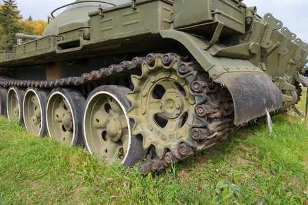 artillery shell: The caterpillar of old tank buried in the ground