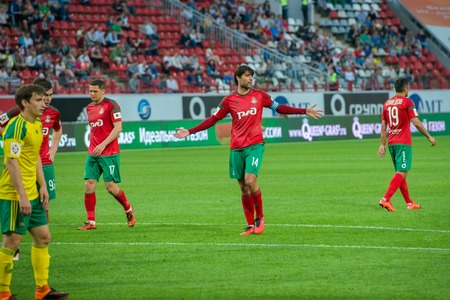 uniform green shoe: MOSCOW - MAY 11, 2016: Quarterback Vedran Corluka (14) on the soccer game Russian Premier League Lokomotiv (Moscow) vs Kuban (Krasnodar), the stadium Lokomotiv Moscow, Russia. Lokomotiv lost 0: 1