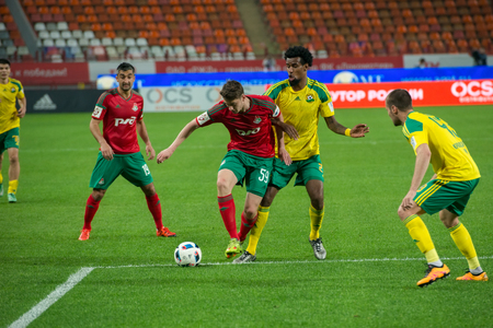 uniform green shoe: MOSCOW - MAY 11, 2016: Midfielder Aleksei Miranchuk (59) on the soccer game Russian Premier League Lokomotiv (Moscow) vs Kuban (Krasnodar), the stadium Lokomotiv Moscow, Russia. Lokomotiv lost 0: 1 Editorial