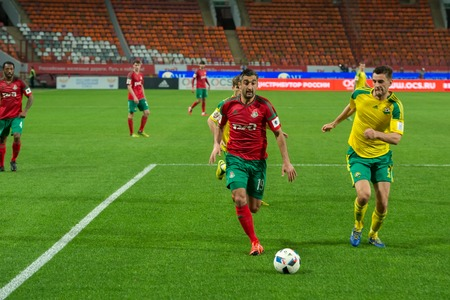 uniform green shoe: MOSCOW - MAY 11, 2016: Midfielder Alexander Samedov (19) on the soccer game Russian Premier League Lokomotiv (Moscow) vs Kuban (Krasnodar), the stadium Lokomotiv Moscow, Russia. Lokomotiv lost 0: 1 Editorial