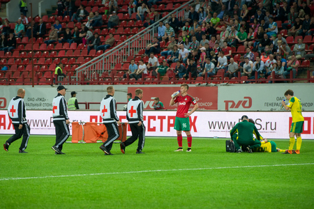 uniform green shoe: MOSCOW - MAY 11, 2016: Medical care in action during the soccer game Russian Premier League Lokomotiv (Moscow) vs Kuban (Krasnodar), the stadium Lokomotiv Moscow, Russia. Lokomotiv lost 0: 1