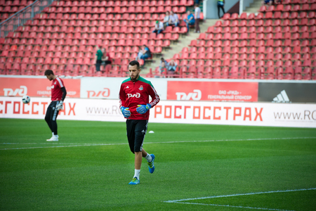uniform green shoe: MOSCOW - MAY 11, 2016: Goalkeeper Guilherme Alvim Marinato before soccer game Russian Premier League Lokomotiv (Moscow) vs Kuban (Krasnodar), the stadium Lokomotiv Moscow, Russia. Lokomotiv lost 0: 1 Editorial