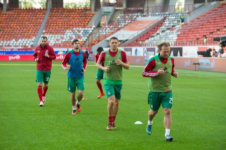 kuban: MOSCOW - MAY 11, 2016: Lokomotiv team in the warm-up before soccer game Russian Premier League Lokomotiv (Moscow) vs Kuban (Krasnodar), the stadium Lokomotiv Moscow, Russia. Lokomotiv lost 0: 1