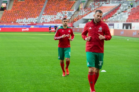 uniform green shoe: MOSCOW - MAY 11, 2016: Midfielder Alexander Samedov (19) before the soccer game Russian Premier League Lokomotiv (Moscow) vs Kuban (Krasnodar), the stadium Lokomotiv Moscow, Russia. Lokomotiv lost 0: 1