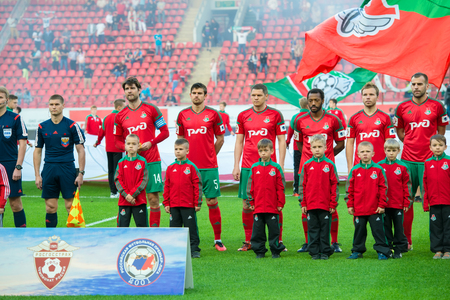 uniform green shoe: MOSCOW - MAY 11, 2016: Lokomotiv team before the soccer game Russian Premier League Lokomotiv (Moscow) vs Kuban (Krasnodar), the stadium Lokomotiv Moscow, Russia. Lokomotiv lost 0: 1