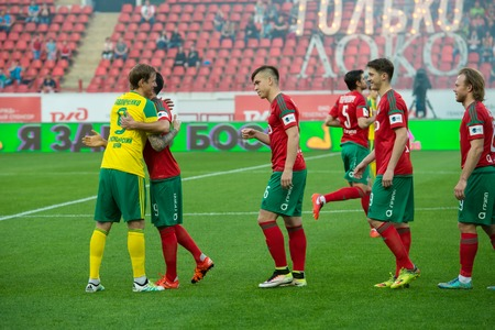 uniform green shoe: MOSCOW - MAY 11, 2016: Greeting rivals before the soccer game Russian Premier League Lokomotiv (Moscow) vs Kuban (Krasnodar), the stadium Lokomotiv Moscow, Russia. Lokomotiv lost 0: 1