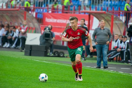 uniform green shoe: MOSCOW - MAY 11, 2016: Rifat Zhemaletdinov striker (96) on the soccer game Russian Premier League Lokomotiv (Moscow) vs Kuban (Krasnodar), the stadium Lokomotiv Moscow, Russia. Lokomotiv lost 0: 1