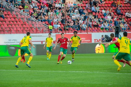 uniform green shoe: MOSCOW - MAY 11, 2016: Soccer players in action during the soccer game Russian Premier League Lokomotiv (Moscow) vs Kuban (Krasnodar), the stadium Lokomotiv Moscow, Russia. Lokomotiv lost 0: 1 Editorial