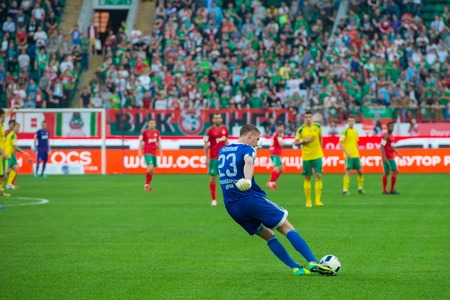 uniform green shoe: MOSCOW - MAY 11, 2016: Goalkeeper Alexander Belov (23) in action during the soccer game Russian Premier League Lokomotiv (Moscow) vs Kuban (Krasnodar), the stadium Lokomotiv Moscow, Russia. Lokomotiv lost 0: 1