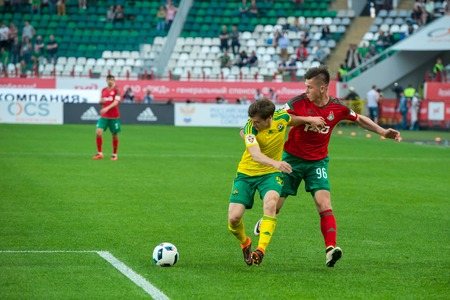 kuban: MOSCOW - MAY 11, 2016: Quarterback Georgy Zotov (15) in action during the soccer game Russian Premier League Lokomotiv (Moscow) vs Kuban (Krasnodar), the stadium Lokomotiv Moscow, Russia. Lokomotiv lost 0: 1