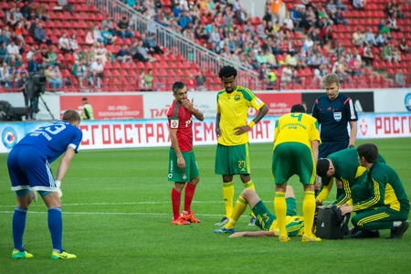 kuban: MOSCOW - MAY 11, 2016: Medical care in action during the soccer game Russian Premier League Lokomotiv (Moscow) vs Kuban (Krasnodar), the stadium Lokomotiv Moscow, Russia. Lokomotiv lost 0: 1