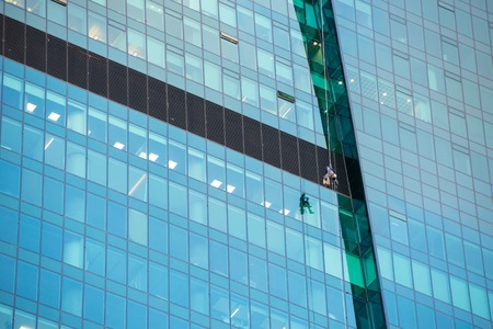 MOSCOW- APRIL 25, 2016:Window cleaners at work on the fortieth floor height Stock Photo