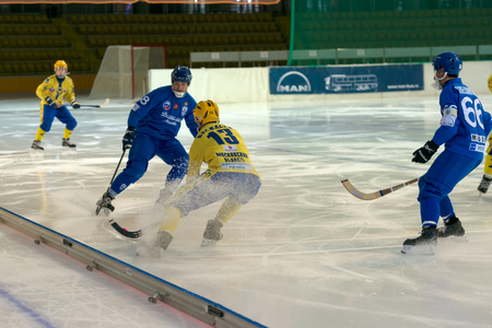bandy: MOSCOW - FEBRUARY 26, 2016: Vadim Vasilyev (13) in action during the Russian bandy league game Dynamo Moscow vs Zorky Krasnogorsk in sport palace Krilatskoe, Moscow, Russia. Dynamo won 9: 2 Editorial