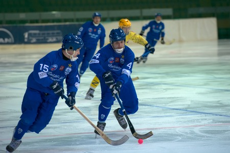 scores: MOSCOW - FEBRUARY 26, 2016: Ivan Shcheglov (4) scores on the Russian bandy league game Dynamo Moscow vs Zorky Krasnogorsk in sport palace Krilatskoe, Moscow, Russia. Dynamo won 9: 2 Editorial