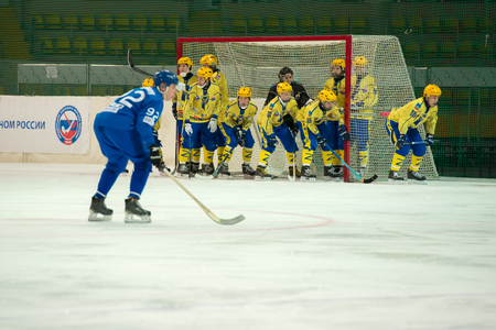 MOSCOW - FEBRUARY 26, 2016: Unidentified players of Zorky Krasnogorsk in action during the Russian bandy league game Dynamo Moscow vs Zorky Krasnogorsk in sport palace Krilatskoe, Moscow, Russia. Dynamo won 9: 2 Editorial