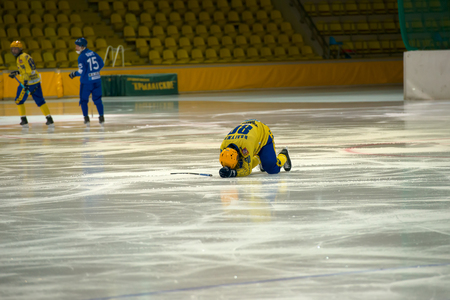 MOSCOW - FEBRUARY 26, 2016: Unidentified pleyers was injured on the Russian bandy league game Dynamo Moscow vs Zorky Krasnogorsk in sport palace Krilatskoe, Moscow, Russia. Dynamo won 9: 2 Editorial
