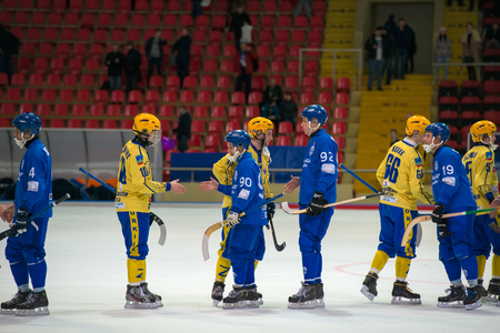 MOSCOW - FEBRUARY 26, 2016: players greeting the opponent at the end the Russian bandy league game Dynamo Moscow vs Sharp Krasnogorsk in sport palace Krilatskoe, Moscow, Russia. Dynamo won 9: 2 Editorial