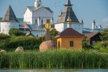 Summer view of The memorial cross and the chapel of Prince Vladimir on the Bank of lake Nero, not far from the medieval Kremlin in Rostov the Great as part of The Golden Rings group of medieval towns of the northeast of Moscow, Russia.