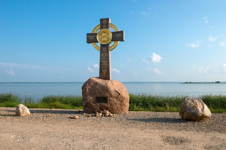 Summer view of The memorial cross and the chapel of Prince Vladimir on the Bank of lake Nero, not far from the medieval Kremlin in Rostov the Great as part of The Golden Rings group of medieval towns of the northeast of Moscow, Russia. Included in the Wo