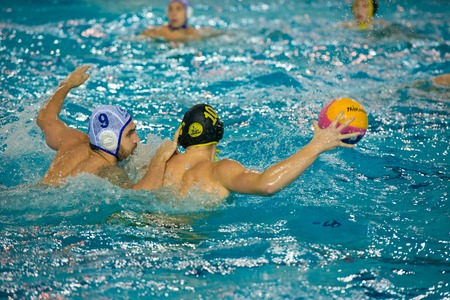 MOSCOW - NOVEMBER 18, 2016: Konstantin Stepanyuk (9) in action at a Russia national championship water-polo game between Dynamo-Moscow (white) vs STORM-2002 (black) Dynamo won 10-6