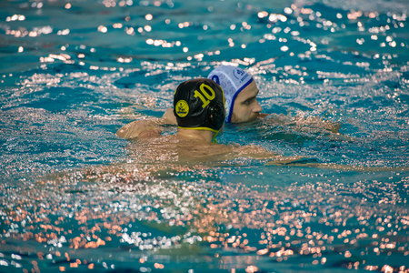 ganado: MOSCOW - NOVEMBER 18, 2016: Konstantin Stepanyuk (9) in action at a Russia national championship water-polo game between Dynamo-Moscow (white) vs STORM-2002 (black) Dynamo won 10-6