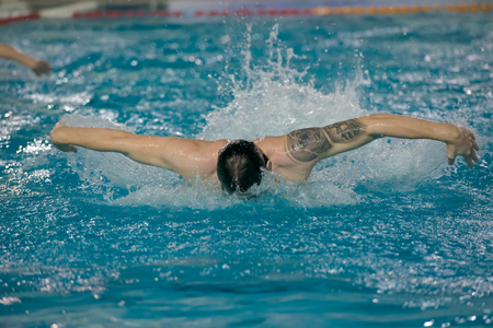 ganado: MOSCOW - November 18, 2016: Unidentified players Dynamo just before a game Dynamo-Moscow (white) vs STORM-2002 (black) Waterpolo championship of Russia. Dynamo won 10-6 Editorial