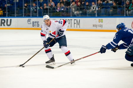 bratislava: MOSCOW, RUSSIA - OCTOBER 12, 2016: Nick Plastino (23) on hockey game Dynamo (Moscow) vs Slovan (Bratislava) on Russia KHL championship in VTB Arena Ice Palace Moscow, Russia. Slovan won 5: 3
