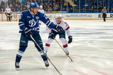 MOSCOW, RUSSIA - OCTOBER 12, 2016: Tsiptsura Cahill (24) on hockey game Dynamo (Moscow) vs Slovan (Bratislava) on Russia KHL championship in VTB Arena Ice Palace Moscow, Russia. Slovan won 5: 3