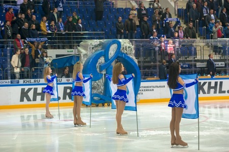 MOSCOW, RUSSIA - OCTOBER 12, 2016: Girls cheerleaders perform on hockey game Dynamo (Moscow) vs Slovan (Bratislava) on Russia KHL championship in VTB Arena Ice Palace Moscow, Russia. Slovan won 5: 3