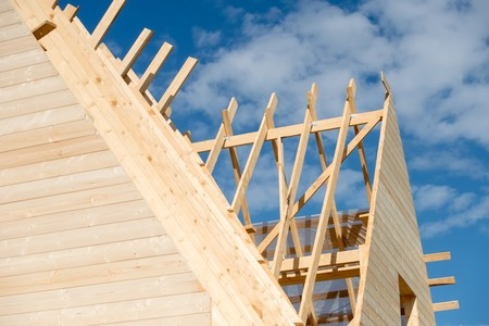 rafters: The rafters of the roof of the new wooden house under construction Stock Photo