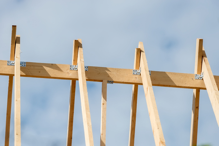 The rafters of the roof of the new wooden house under construction Stock Photo