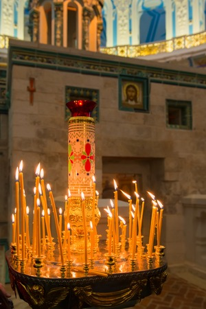 ISTRA, RUSSIA - JANUARY 3, 2017: Candles near chapel of the Holy Sepulchre in the Voskresensky New-Jerusalem Stavropegial male monastery, Istra, Moscow region