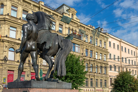 RUSSIA, SAINT PETERSBURG - AUGUST 18, 2017: Famous sculpture Horse walking with a young man on Anichkov Bridge across the Fontanka River, designed by the Russian sculptor Baron Peter Klodt