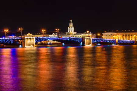 RUSSIA, SAINT PETERSBURG: Landmarks of Vasilievsky island spit - The Palace Bridge, rostral column and old stock exchange building. Urban landscape of St Petersburg in a dark summer night