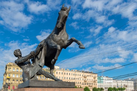 RUSSIA, SAINT PETERSBURG - AUGUST 18, 2017: Famous sculpture The Horse Tamers on Anichkov Bridge across the Fontanka River, designed by the Russian sculptor Baron Peter Klodt