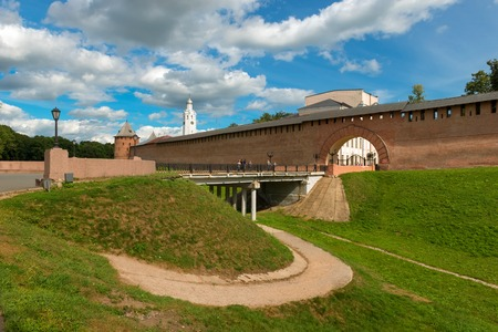 Novgorod region, Myasnoy Bor village, Russia - August 14, 2018: Resurrection arch and the bridge entrance to the Kremlin. Walls and towers of the Novgorod Kremlin, Russia.
