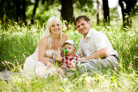 happy family together in park look at me