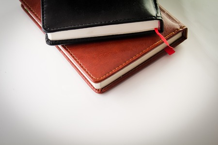 the compositthe composition of notebooks with red tabion of notebooks with red tab