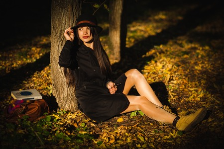 Girl in the hat in autumn park Stock Photo