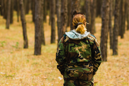 woman in Pine forest from back Stock Photo
