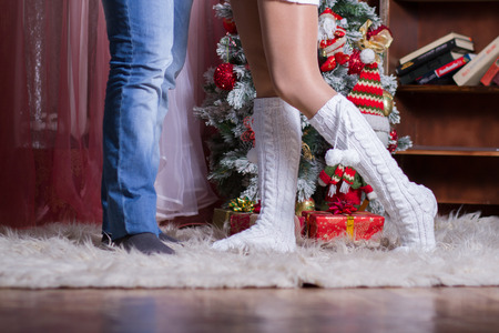 couple of male and female legs on the background Christmas Interior